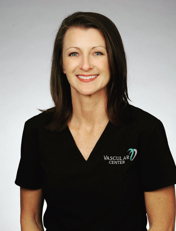 KELLY PEEK Registered Vascular Specialist, Nutrition Coach in a black nursing shirt with the vascular logo on it
